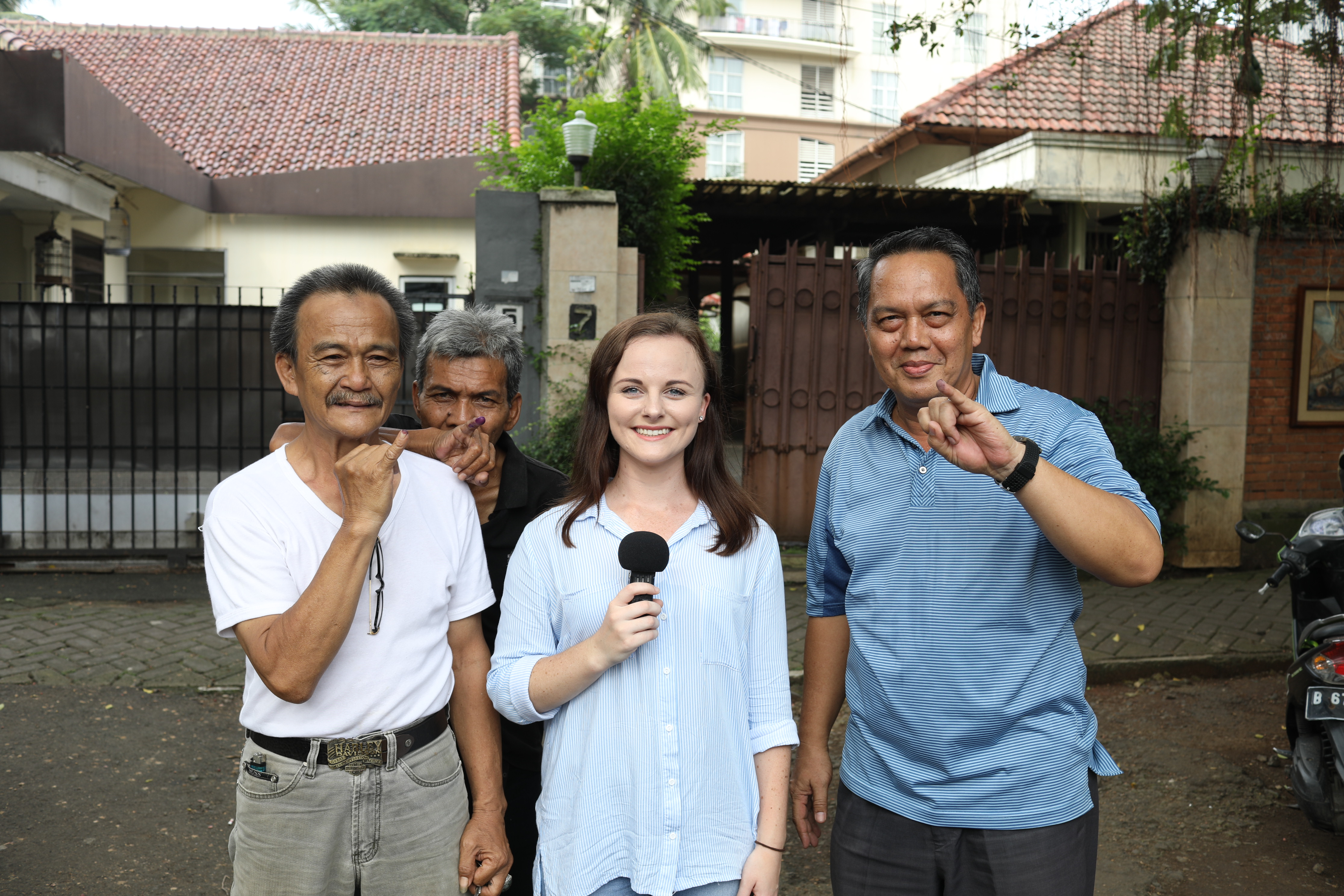 Sophie Volker reporting from a Jakarta polling place with locals keen to show off their freshly inked fingerprints.