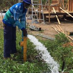Man-with-gushing-water-pipe
