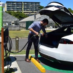 Andrew Wilson charges a Tesla car at UQ St Lucia.